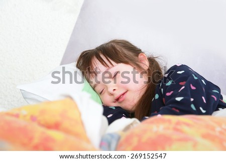 Little girl sleeping at home - stock photo