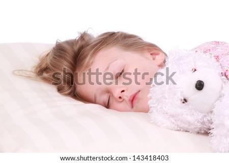 Little girl sleeping with a bear - stock photo