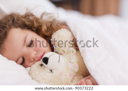 Little girl sleeping with her daddy - stock photo
