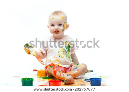 Little girl soiled by multi-colored paints on a white background - stock photo
