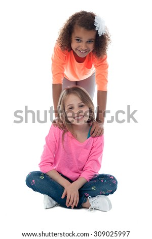 Little girl standing behind her friend - stock photo