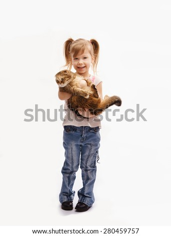 little girl stands and hugs cat - stock photo