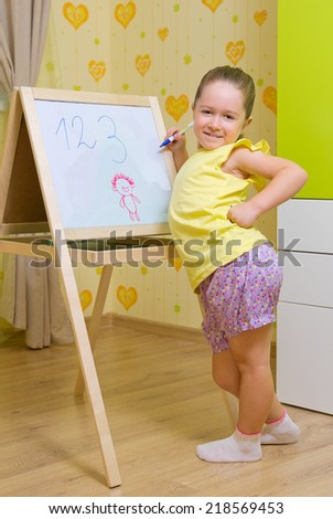 Little girl studying at home - stock photo