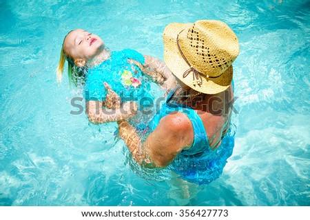 Little girl swimming - stock photo