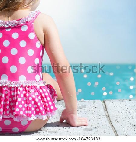 Little girl swimming in pool - stock photo