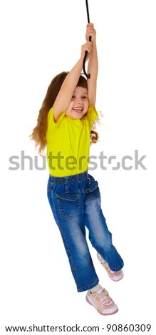 Little girl swinging on a rope - stock photo