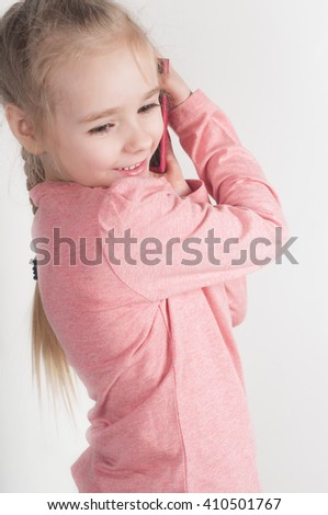 Little girl talking on mobile  - stock photo
