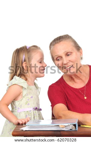 Little girl talks to teacher - stock photo