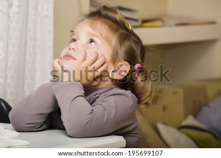 Little girl thinking  - stock photo
