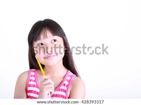 Little girl thinking on white background. Young girl holding yellow pencil look up. - stock photo