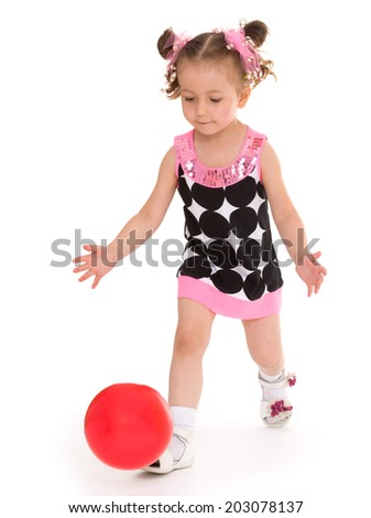 little girl tosses the ball isolated on white background, sports life,happiness concept,happy childhood,carefree childhood,active lifestyle - stock photo