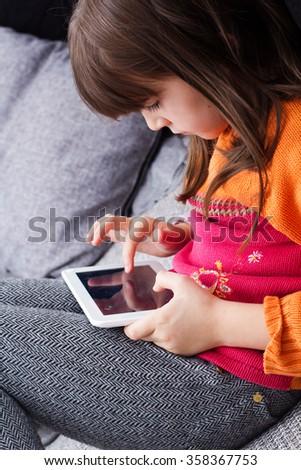 Little girl using digital tablet - stock photo