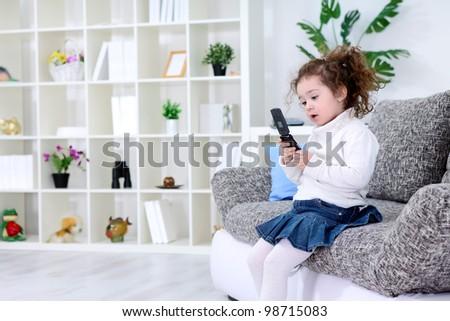 Little girl using smart phone - stock photo
