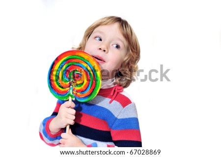 little girl very happy to get huge lollipop - stock photo