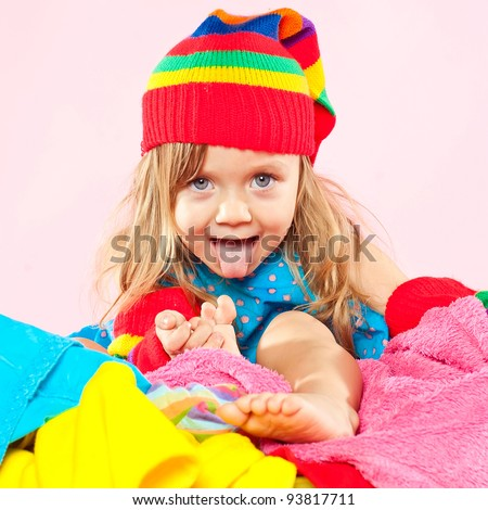 Little girl washing clothes - stock photo