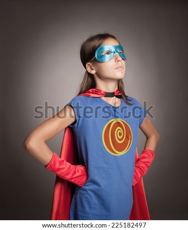 little girl wearing a superhero costume - stock photo