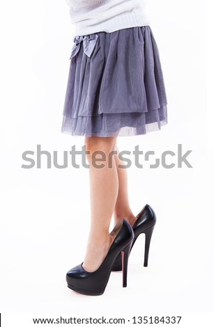 little girl wearing big mothers shoes - stock photo