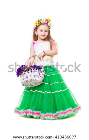 Little girl wearing like spring posing with basket of flowers. Isolated on white - stock photo