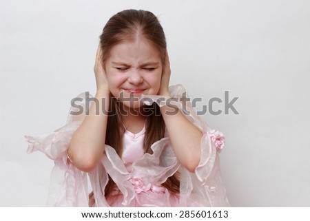 Little girl wearing pink dress as a princess - stock photo