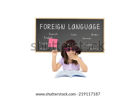 Little Girl wearing sunglasses holding Post it flag, book, reading glasses in front of classroom blackboard Foreign Language (french, english, spanish, german, italian, latin, chinese, hebrew arabic)  - stock photo