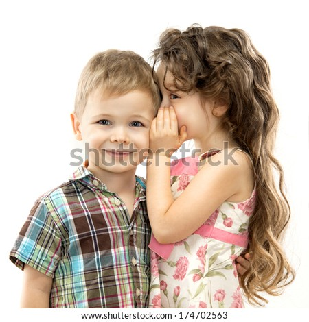 Little girl whispering something to boy. Love concept. Isolated on white background - stock photo