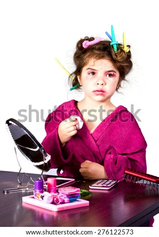 little girl who caught the parents for applying makeup - stock photo