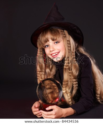 Little girl witch holding crystal ball. Fortune telling. - stock photo