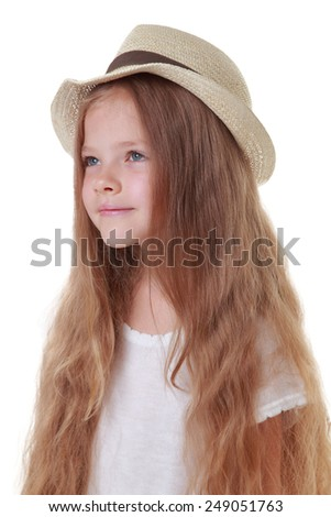 little girl with a beautiful smile in a summer dress and hat - stock photo