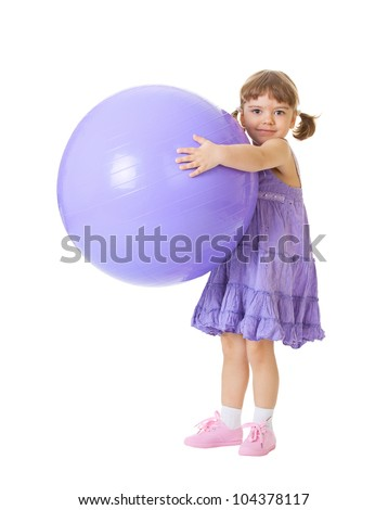 Little girl with a big purple ball isolated on white background - stock photo
