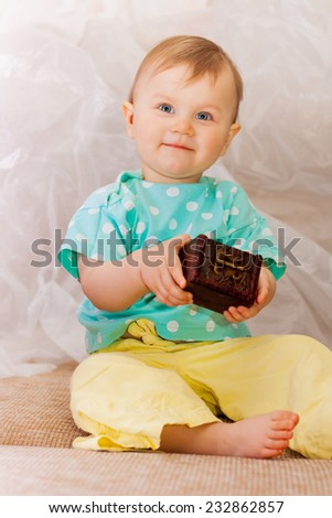 Little girl with a fabulous trunk - stock photo