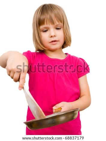 little girl with a frying pan - stock photo