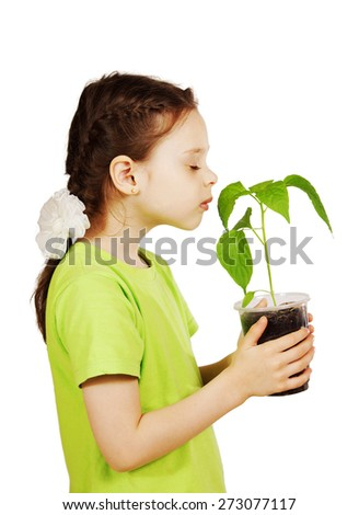 Little girl with a new green seedling isolated over white background - stock photo