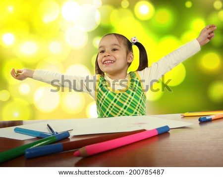 little girl with a pencil next to summer background - stock photo