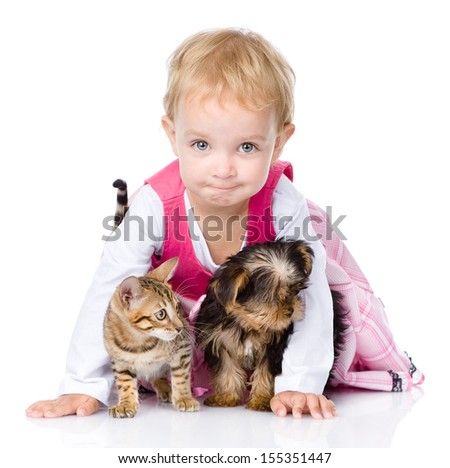 little girl with a puppy and a kitten. isolated on white background - stock photo