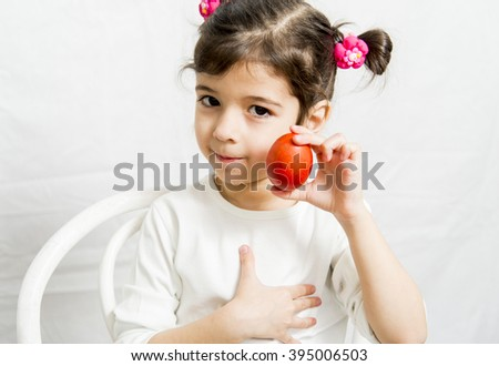 Little girl with a red Easter egg - stock photo