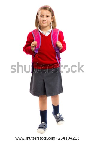 Little girl with a school bag isolated on white background - stock photo