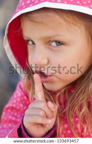 little girl with a secret - stock photo