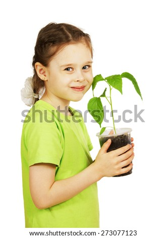 Little girl with a seedling in the pot isolated over white background - stock photo