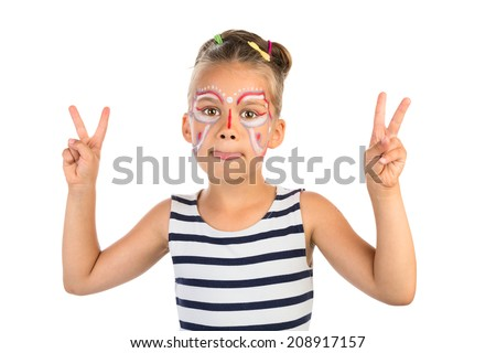 Little girl with an abstract paint on her face , showing her tongue and a victory sign with both hands, isolated - stock photo