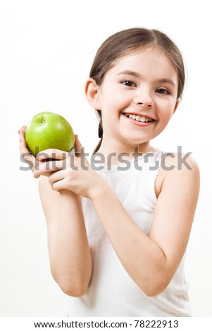 little girl with apple is smiling - stock photo