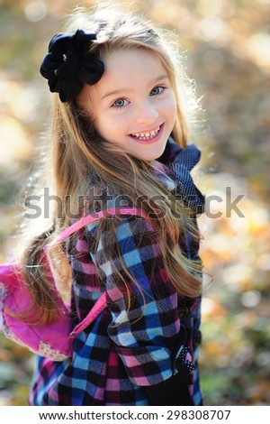 little girl with backpack back to school - stock photo