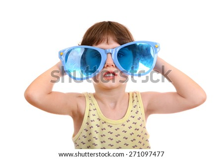 Little Girl with Big Blue Glasses Isolated on the White Background - stock photo