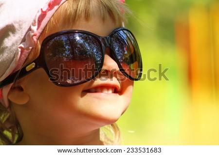 Little girl with big sunglasses - stock photo