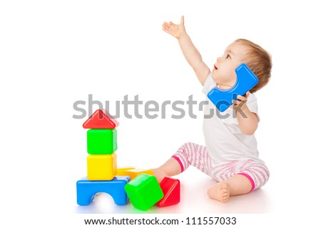 Little girl with blocks, isolated on white - stock photo