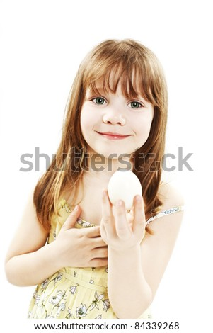 Little girl with boiled  egg - stock photo