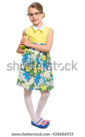 Little girl with books isolated - stock photo