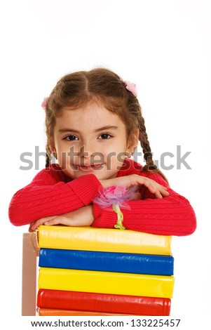 little girl with books on white background - stock photo