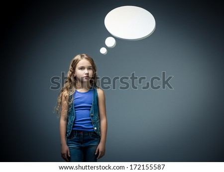Little girl with bubbles in studio - stock photo