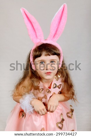 Little Girl with Bunny Ears Isolated on the Grey Background - stock photo