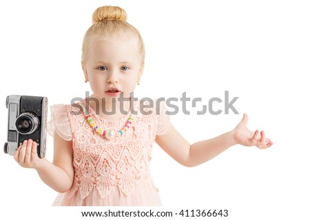 little girl with camera made helpless gesture, looking at camera - stock photo